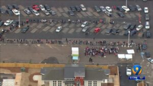 Aerial image of 1300 people lined up for affordable housing in Charlotte
