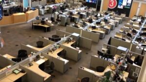 A view of empty desks in a newsroom during the pandemic