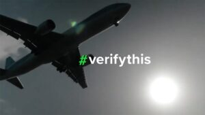 Airplane in the sky with hashtag verifythis overlay